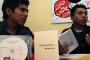 """LPZ02- LA PAZ (BOLIVIA), 03/08/2012.- Roberto Condori (i) y Edgar Soliz (d), autores del """"Diccionario marica"""", muestran un ejemplar hoy, viernes 3 de agosto de 2012, en La Paz (Bolivia). Condori y Soliz elaboraron la obra para describir de forma """"poética"""" la pluralidad de sus identidades y en rechazo a lo que consideran los """"estereotipos"""" excluyentes del ser gay en Bolivia. EFE/Martin Alipaz"""